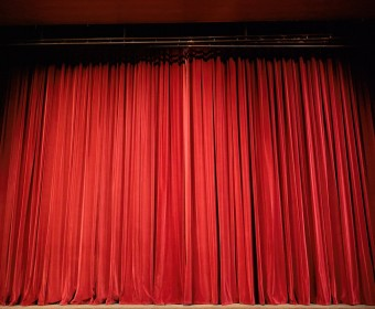 A stage with curtains